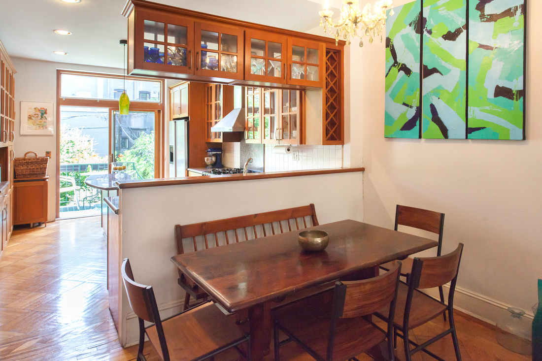 Clean and clear dining and kitchen area