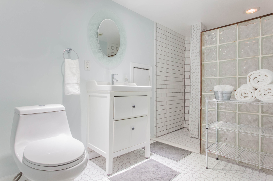 Clean and staged white bathroom